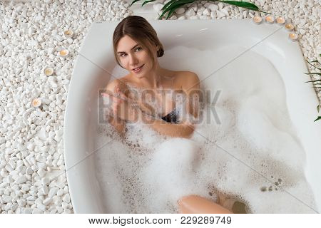 Comfort Zone! Good-looking Gorgeous Young Woman Taking A Relaxing Bath, Holding Her Shoulders And At