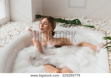 The Place That Leaves You Feeling Great! Attractive Enjoying Young Girl Blowing At The Soap Foam In