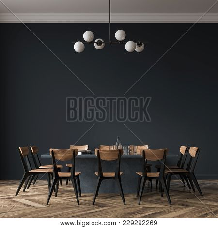 Long Black Dining Room Table With Black And Wooden Chairs Standing In A Black Room. 3d Rendering Moc