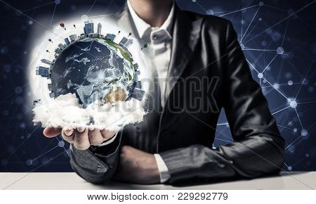 Closeup Of Businessman In Suit Keeping In Hands Earth Globe With Buildings And Flying Balloons. Elem