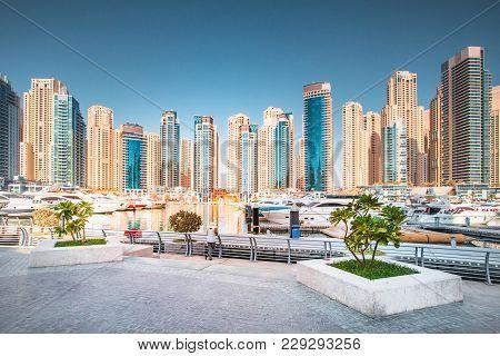 Dubai Skyline, Uae. Luxury Residential District In Dubai. Marina With Yachts On Residential Skyscrap