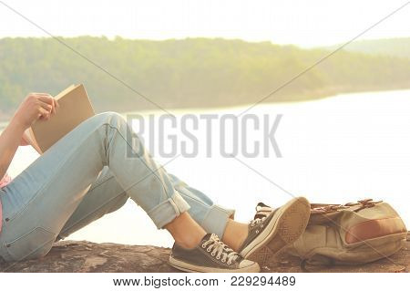 Feet Of Young Girl Sleep In The Park On Nature, Relax Time On Holiday In Beautiful Nature Concept Tr