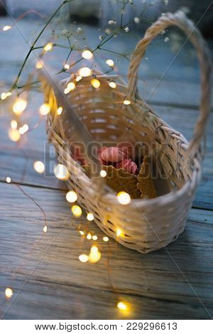 Marshmallow In A Basket With A Horn With Garlands.