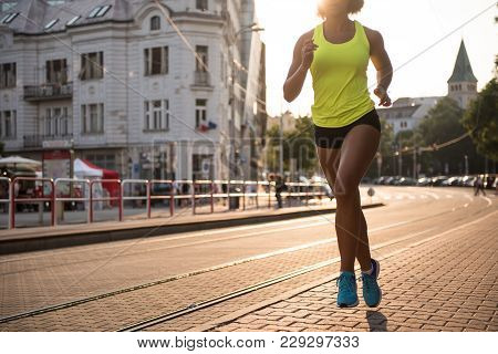 Athelitic Fit Woman Undergoing Hard Training Outdoors