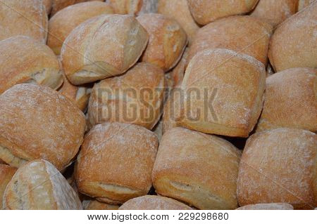 Zoom On A Filled Basket With Small Bread