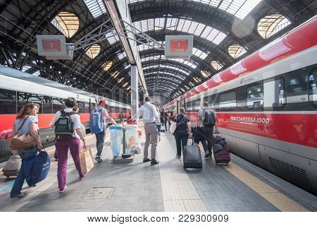 Milan, Italy - 21 May 2017: Peopla Walking Around Milano Centrale Station With Trains At Platforms.