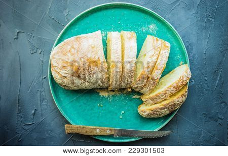 Fresh Baked Italian Bread - Ciabatta  On Rustic Table With Napkin