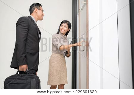 Lovely Reception press the elevator for guest Happy Businessman in Hotel. Classy welcome Concept poster