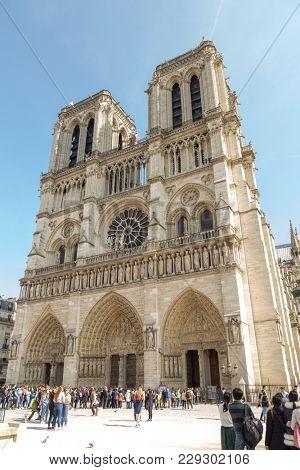 Paris, France, March 27 2017: famous Notre Dame cathedral facade saint statues. UNESCO World Heritage Site