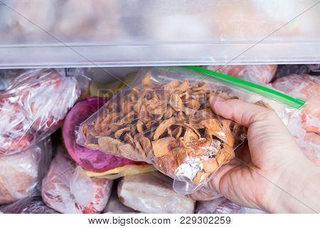 Refrigerator With Frozen Food. Frozen Dried Fruits In A Package. Open Fridge Freezer (meat, Milk, Ve