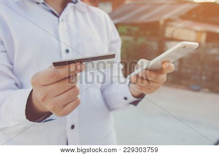 Man Hands Holding Credit Card And Using Smart Phone For Online Payment, Online Shopping,