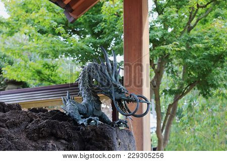 Japanese Fountain In The Form Of A Dragon
