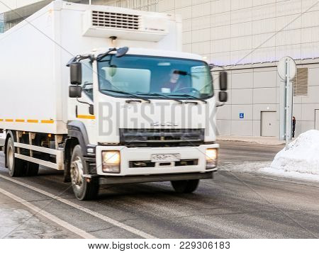 Moscow, Russia - February, 28, 2018: Truck drives by the winter road in Moscow near Crocus Expo Exebishion Center