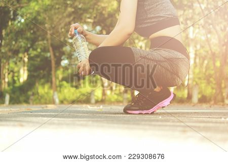 Woman Drinking Water Form Bottle. After Exercise. Sport Exercise Concept.
