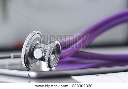 Stethoscope With A Tablet Computer Lie On A Table.