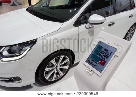 Geneva, Switzerland - March 4, 2015: Tablet With Citroen C4 Specifications On The 85th International