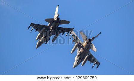 Leeuwarden, Netherlands - Mar 28, 2017: Nato F-16 Fighter Jets In Flight Over Leeuwarden Airbase Dur