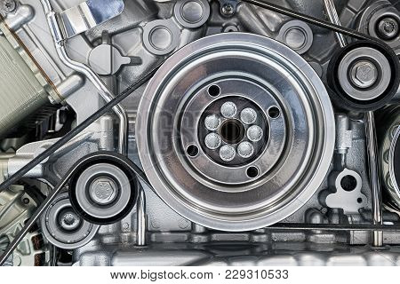 View On Pulley And Belts On A Car Engine
