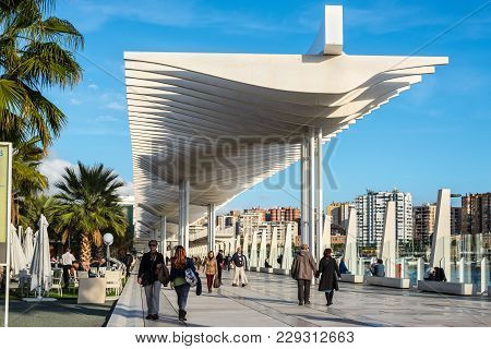 Malaga, Spain - December 7, 2016: People Are Walking Along The Embankment (paseo Del Muelle Dos Prom