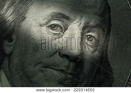 Hundred Dollars Bill - Benjamin Franklin. Selective Focus Face