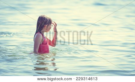 Little Girl Child Having Fun In Ocean. Kid And Woman Bathing In Sea Water. Summer Vacation Holiday R