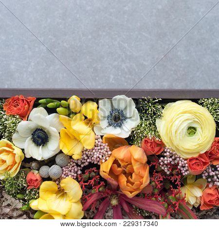 Flowers In Giftbox On Grey Background. Bouquet Of Various Flowers In Old Wooden Rustic Box, Top View