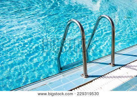 View Of Clear Transparent Pool Water And Railings