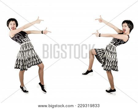 Fashion Beautiful Brunette Woman In Black And White Dress Outrageously Points To Empty Space Isolate