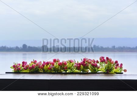 Beautiful Artificial Roses Decorated On The Balcony , Viewing Mekong River In The Background , Nong