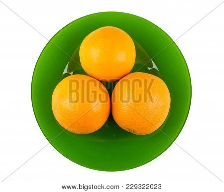 Ripe Oranges In Green Plate Isolated On White Background. Top View