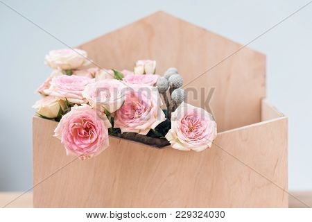 Flowers In Giftbox On Grey Background. Bouquet Of Pink Roses In Wooden Envelope Box. Copy Spase For