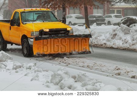 Snow Plough Truck Clearing Road After Whiteout Winter Snowstorm Blizzard For Vehicle Access Snow Bli