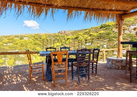 Table And Chairs In Traditional Greek Tavern On Zakynthos. Zante, Greece