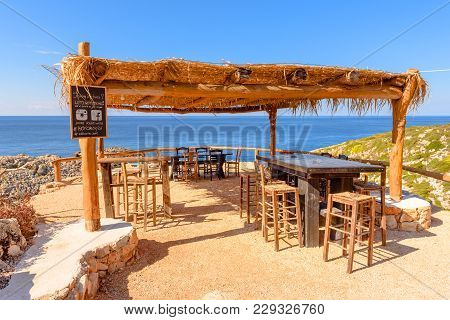 Zakynthos, Greece - October 1, 2017: Table And Chairs In Traditional Greek Tavern With View Of Beaut