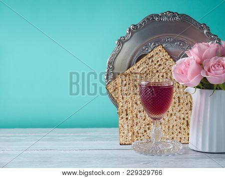 Passover Holiday Celebration Concept With Wine, Matzo, Flowers And Seder Plate.
