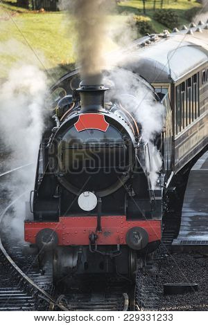 Beautiful Old Vintage Steam Railway Engine With Full Steam Blowing