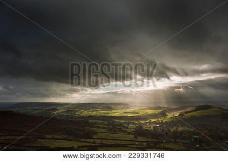 Beautiful Sunbeams Over Big Moor In The Peak District Landscape In Autumn