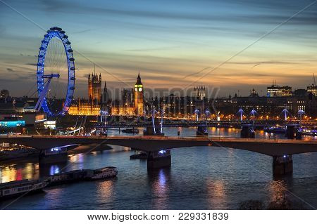 Beautiful Landscape Image Of The London Skyline At Night Looking Along The River Thames