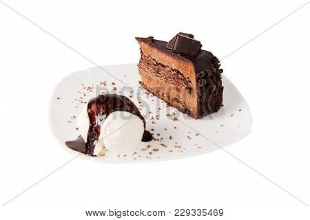 Chocolate Cake And Ice Cream Whith Chocolate Sauce On Plate, Isolated.