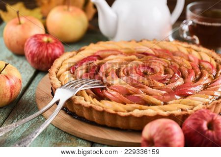 Apple Rose Tart. Tasty Homemade Pie Served With Tea And Apples Closeup