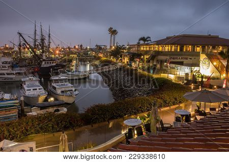 Looking Over Water Front Cafe And Dive Shop In The Calm Morning Lights Of Winter Rain.  Shot On Marc