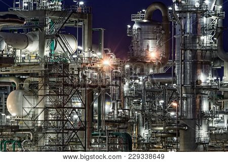 Oil Refinery Industrial Petrochemical Plant Factory After Sunset.