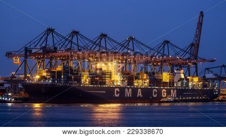 Rotterdam - Jul 9, 2012: Container Ship Being Unloaded In The Port Of Rotterdam.