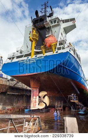 Rotterdam, Netherlands - Sep 5, 2015: Dock Workers At Work In A Ship Repair Drydock.