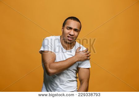 Pain Concept. Beautiful Male Portrait Isolated On Orange Backgroud. Young Emotional Surprised Afro M