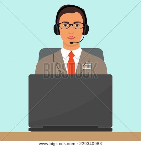 Man In A Business Suit, In Headphones With Microphone Sitting At The Desk With Laptop Computer. Webi