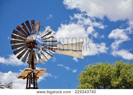 Windmill On An Agricultural Farm In Usa.