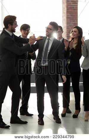 Businessmen are congratulating their successful sales.