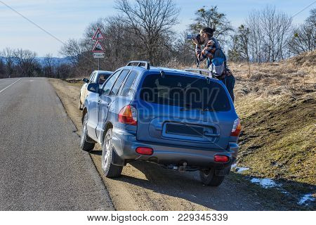 The Young Man Is Shooting From The Car