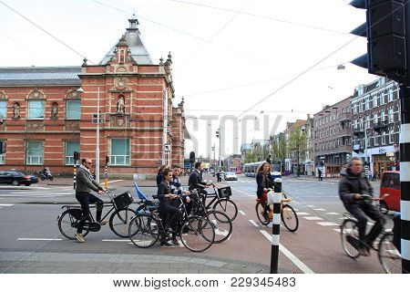 Amsterdam, Netherlands - May 4, 2016: Crowd Of People Ride Bicycles At The Museum Quarter In Amsterd